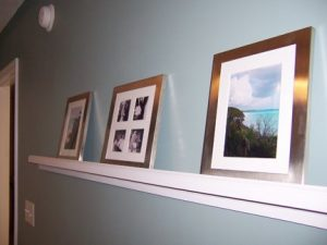 Photo Grouping on Master Bedroom Wall: After