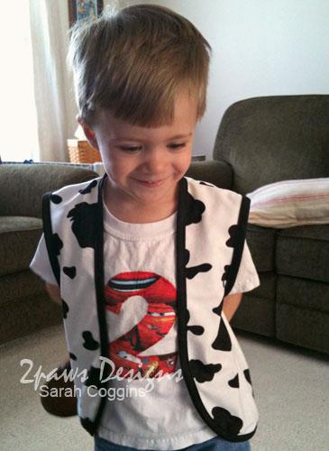 Toddler modeling a handmade cowboy Woody vest.