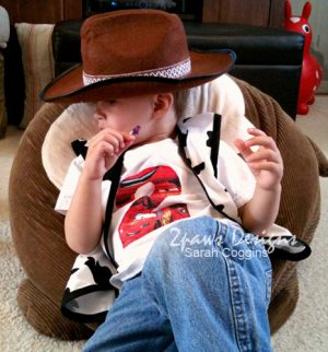 Toddler modeling a cowboy hat and handmade Woody vest.
