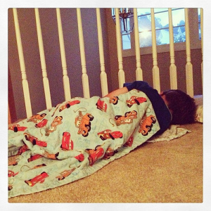 """#weekinthelife He came out of his room. Said, """"it's still sleep time!"""" Went back in and shut the door. Minute later he's back out w/2 loveys and his Cars blanket and curling up in the hall. #preschooler #lethimstayuptoolatelastnight"""