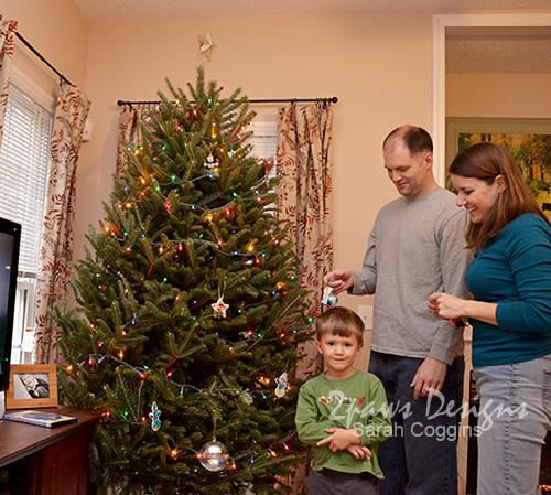 Family Trimming the Christmas Tree