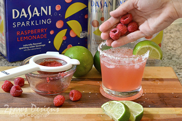 Raspberry Lemon-Lime Naptime Mocktail Recipe: Garnish with Frozen Raspberries & Lime Wedge
