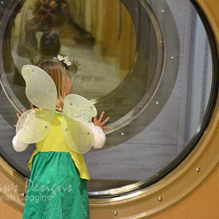 Tinkerbell Peeking through Porthole on Disney Magic
