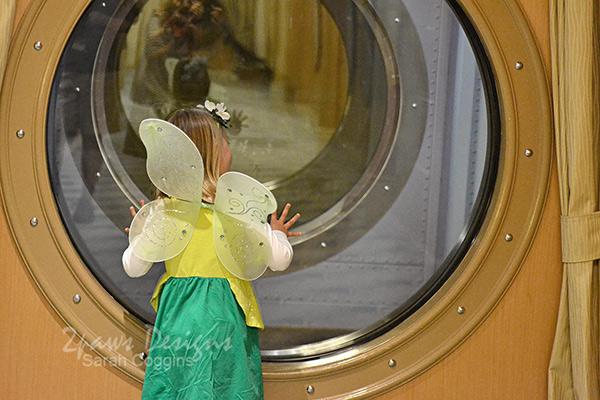 Tinkerbell Peeking through Porthole on Disney Magic