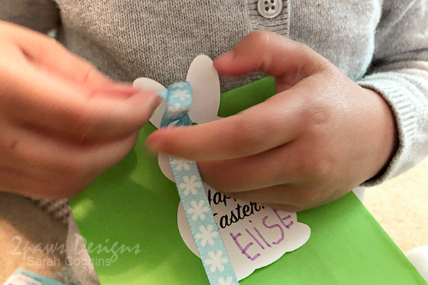 Tying Easter Bunny Tags on Gift Bags