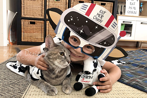 Cat and Child Dressed up for Cow Appreciation Day at Home