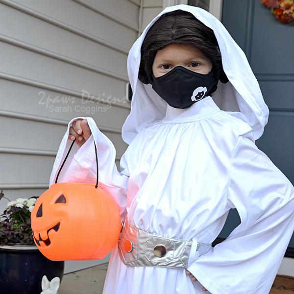 Princess Leia holding Orange Pumpkin Treat Bucket