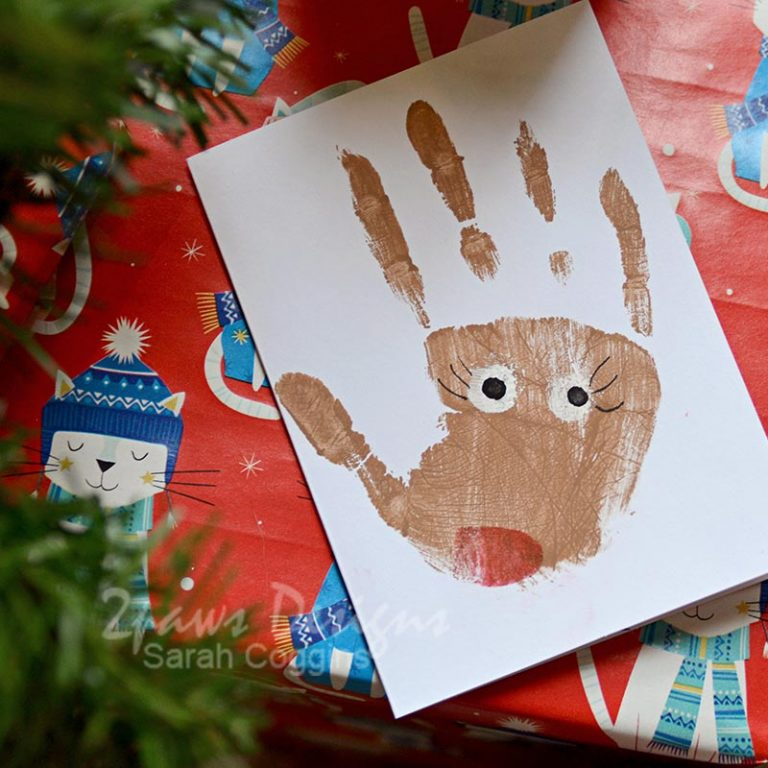 Handprint Reindeer Card on Christmas Gift