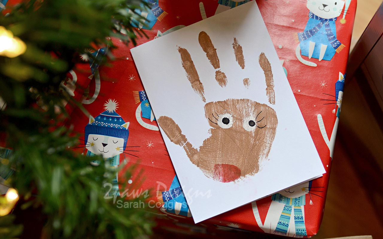 Handprint Reindeer Card on Christmas Gift
