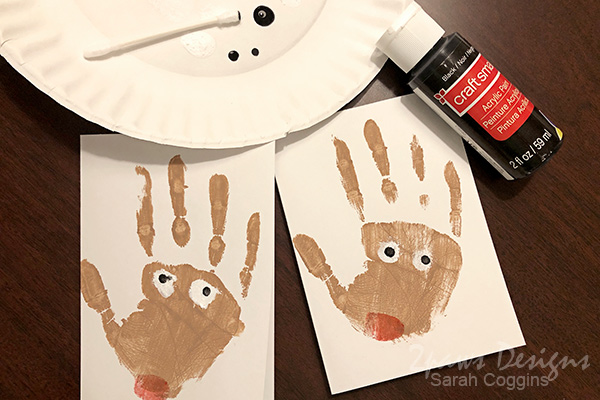 Painting Eyes on Handprint Reindeer Cards