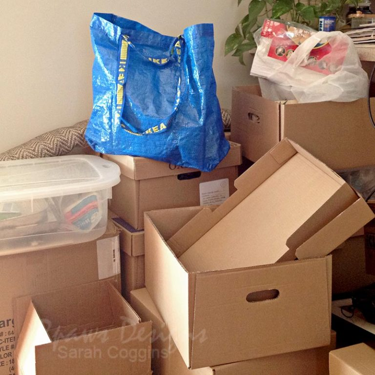 Cardboard boxes stacked and ready for packing to move.